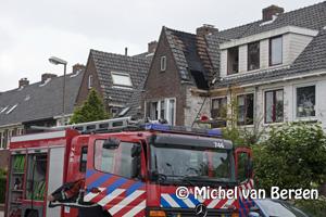 Foto Zolder buurvrouw in de brand door werkzaamheden aan gevel Lorentzkade