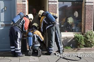Foto Brand aan het kozijn in de Maerten van Heemskerckstraat in Haarlem