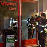 Brand in winkel aan de Kleine Houtstraat in Haarlem