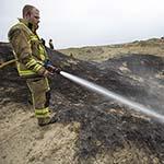 Stuk duinen afbrand aan de Boulevard Barnaart in Zandvoort