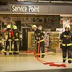 Machine in de brand gevlogen in winkel op Schiphol