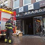 Meterkast in de brand gevlogen in kledingwinkel Grote Houtstraat