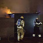 Schuur door brand verwoest aan de Bloemstraat in IJmuiden
